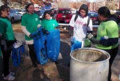 International students on the URI recycling team improve their English and learn about sustainability by cleaning up at URI football games. (Tim Faulkner/ecoRI News)