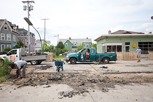 Much of the paved parking space at Cluck! on Broadway in Providence was recently ripped up to make way for trees and vegetation. (Rachel Playe)
