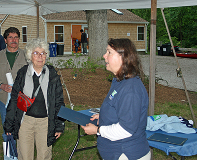 Madeline Jeffery, left, and Denise Poyer at last year's Wood-Pawcatuck Watershed Association annual meeting. (David Smith)