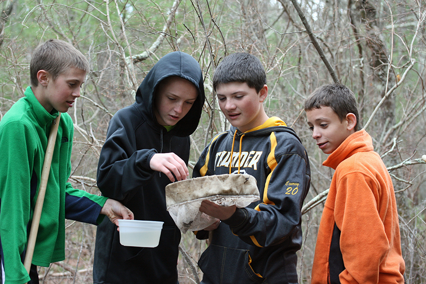 About 20 Chariho Middle School seventh-graders, including, from left, Kyle Waterman, John Hacton, Cooper Conroy and Paul Allen, recently explored Meadow Brook for a project that ties together science, math and English. (David Smith/ecoRI News photos)