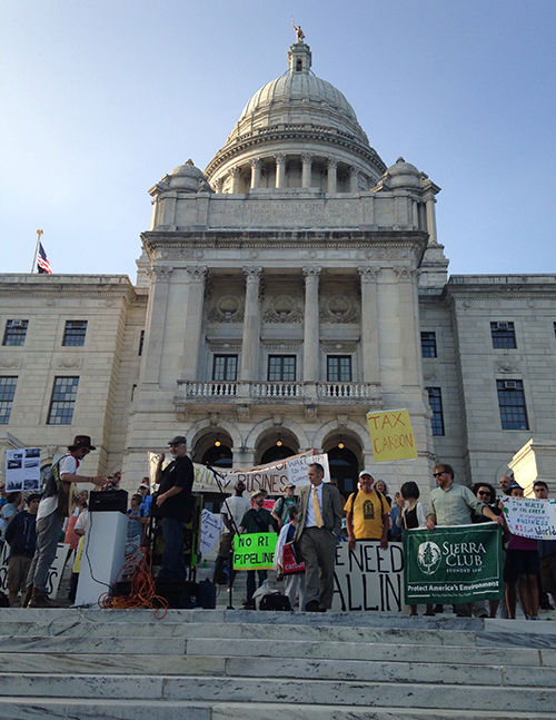 A recent rally at the Statehouse stressed the importance of environmental and social justice. (Abbey Greene/ecoRI News)