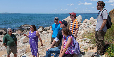 Rhode Island College adjunct professor of geography Jennifer Bonin, second from left, with students during a recent trip to Napatree Point in Westerly, R.I. (RIC)