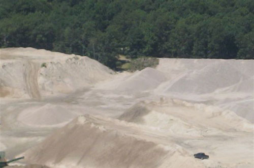An aerial photo of the dust piles that can be found at Copar Quarries in Westerly, R.I. There are some 40,000 tons of stone dust on the property. (Steve Dubios)