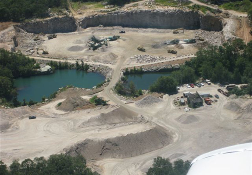 Mining operations at the long-dormant Westerly Granite Co. property in the village of Bradford, R.I., began in late 2010. The headaches — literally and figuratively — began about a year later and persist today. (Steve Dubios)