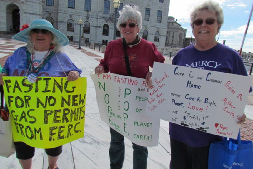 Jan Very-Creamer, left, Patricia Fontes, middle, Sister Mary Pendergast and other activists began fasting Sept. 22 in front of the Statehouse to protest the expansion of fossil fuels. (Tim Faulkner/ecoRI News)