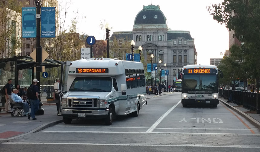 Low-income seniors and people with disabilities currently ride RIPTA buses for free, but the authority is considering charging them half the price of the base fare — a dollar per ride. Many who live on limited and fixed incomes are unhappy with the proposed increase. (Kevin Proft/ecoRI News)