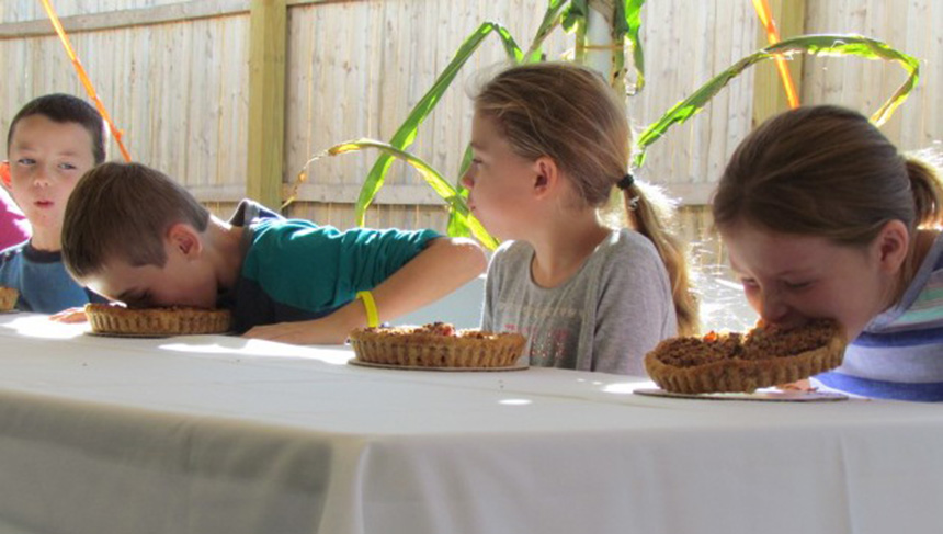 Kids chowed down during Hope & Main's pie-eating contest on Oct. 11 to celebrate the food incubator's one-year anniversary. The pies were locally made. (Tim Faulkner/ecoRI News)