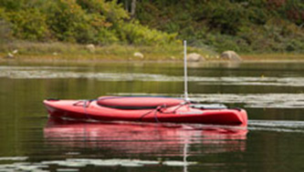 The use of an unmanned kayak is aiding in the study of fish consumption and public health. (Nora Lewis/URI)