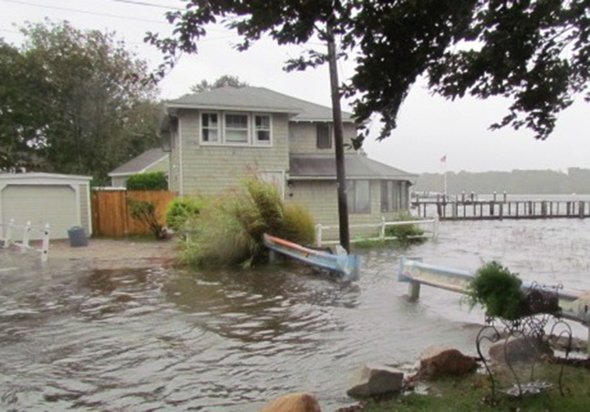 This home on King Philip Avenue in Barrington, R.I., is one of six in the town to recently receive federal money to elevate 5 feet or more. This photo was taken during 'king tide' on Sept. 30. (Tim Faulkner/ecoRI News)