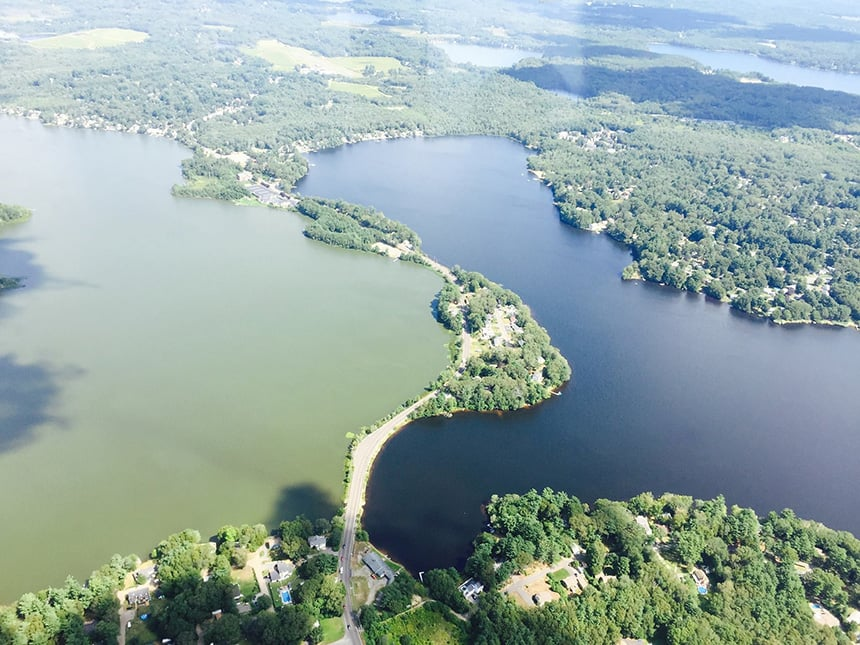 West Monponsett Pond's water-quality problems are obvious. Thick mats of blue-green algae suffocate the Halifax, Mass., waterway for much of the year, emitting a foul odor that stinks up the neighborhood and makes the pond unsafe for recreational uses. This aerial photo was taken last August by Halifax Police Chief Ted Broderick.