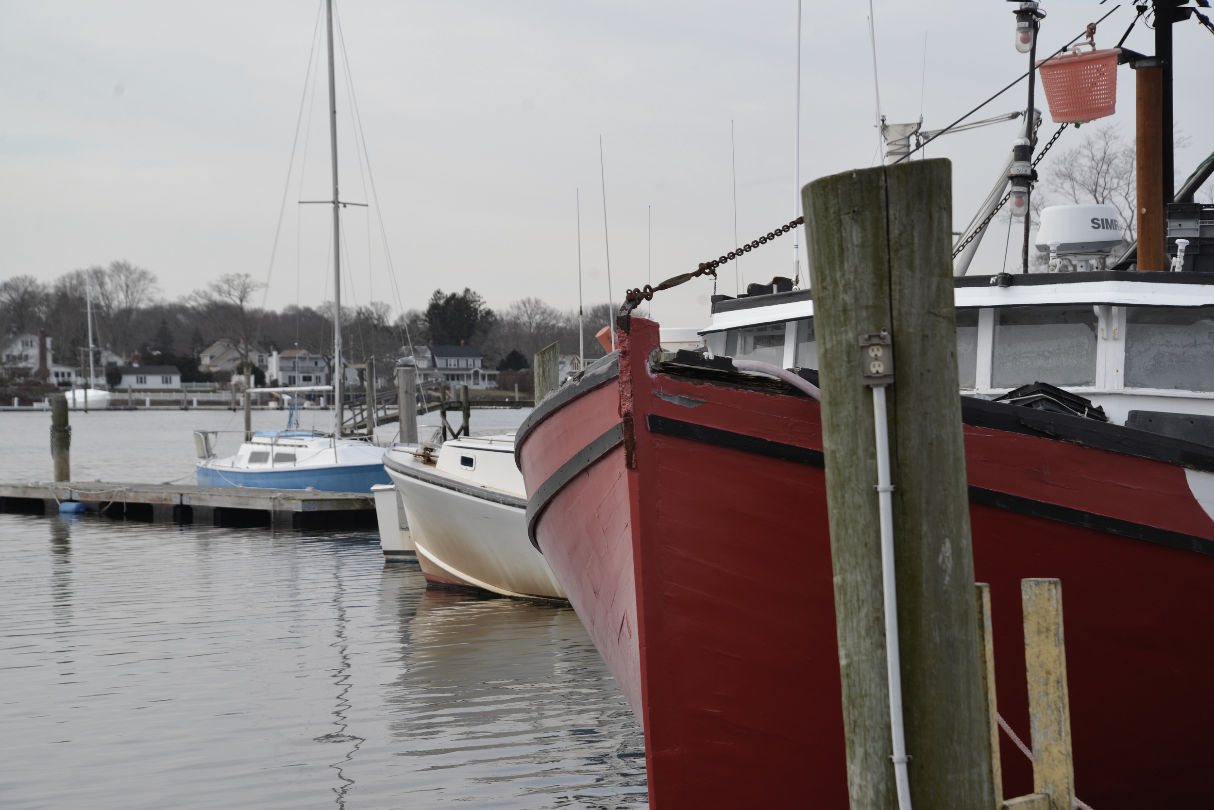 Fishing boats share space with recreational craft in Wickford Harbor. (Joanna Detz/ecoRI News)