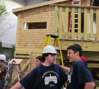 Students from Narragansett High School joined 19 other high schools to build the solar tree house for the Rhode Island Home Show. (Tim Faulkner/ecoRI News)