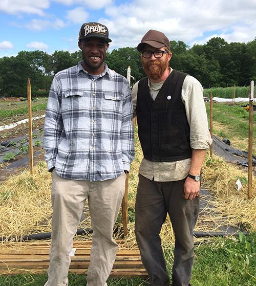 David Kuma, left, is learning to farm under the tutelage of Ben Torpey. (Leigh Vincola/ecoRI News)