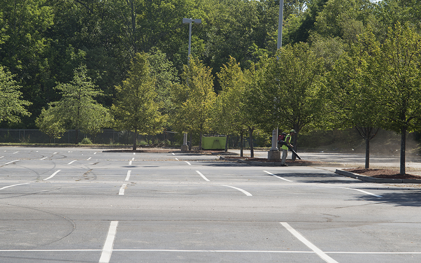 The vast parking lot of another vacant Lowe's, this one in Woonsocket, is kept clean with a leaf blower. (Joanna Detz/ecoRI News)