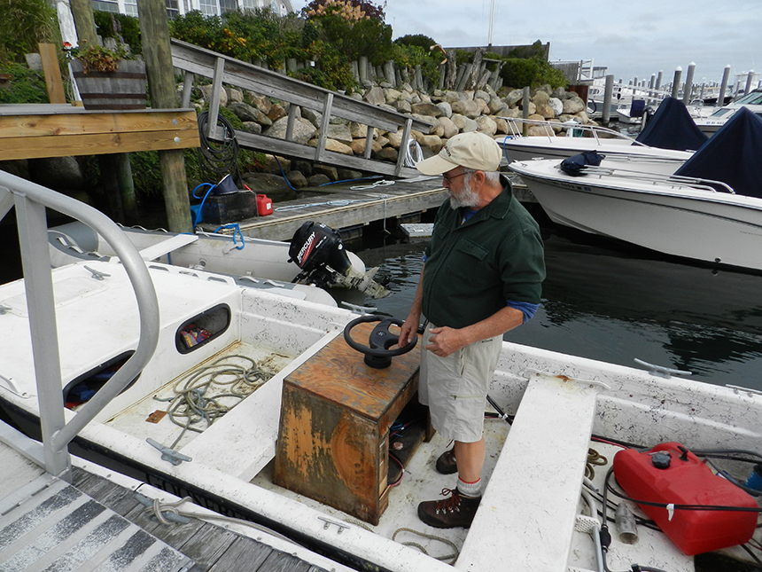 David Blaney in a boat he'll use to support his kelp operation, in the marina managed by his brother.