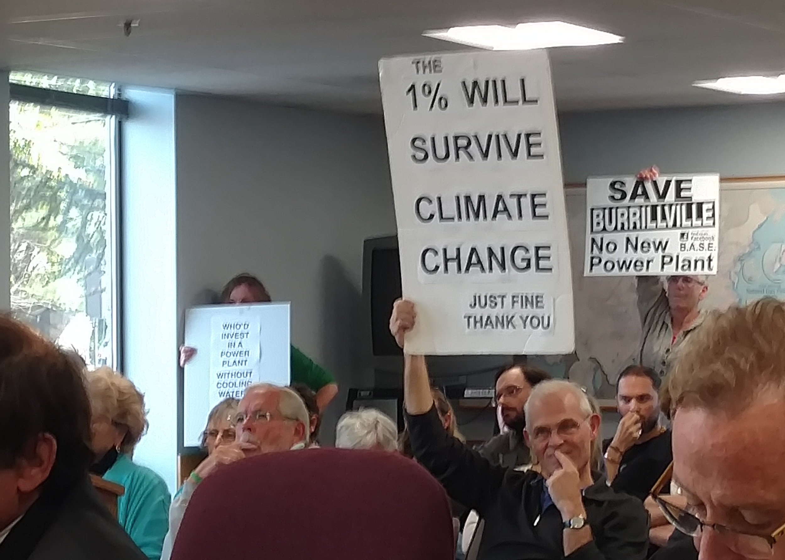 Opponents of the proposed fossil-fuel power plant let their feelings be known during the Oct. 13 hearing. (Tim Faulkner/ecoRI News)