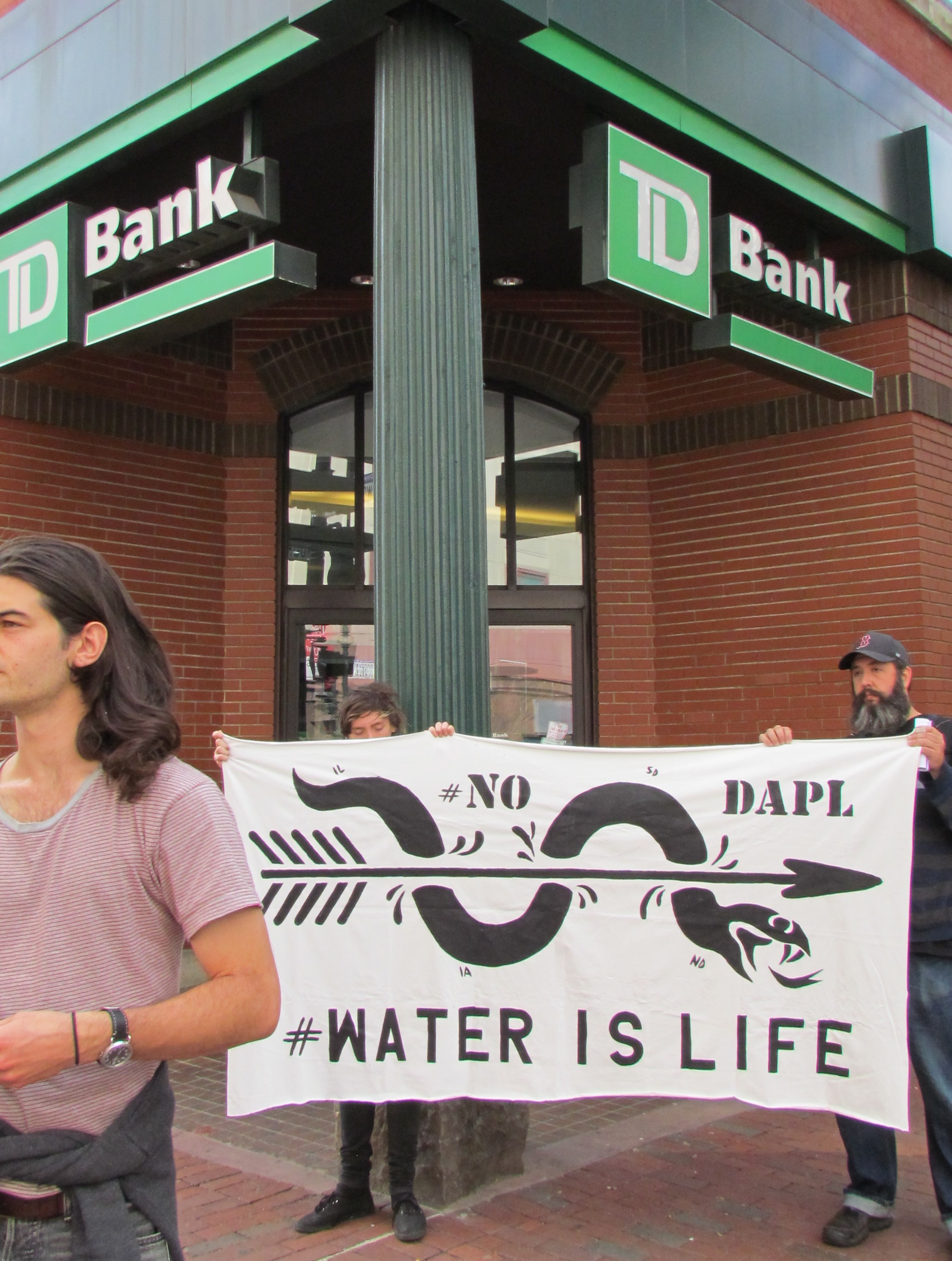 Two activists were arrested Oct. 20 for protesting inside the TD Bank on Westminster Street in Providence. (Tim Faulkner/ecoRI News photos)