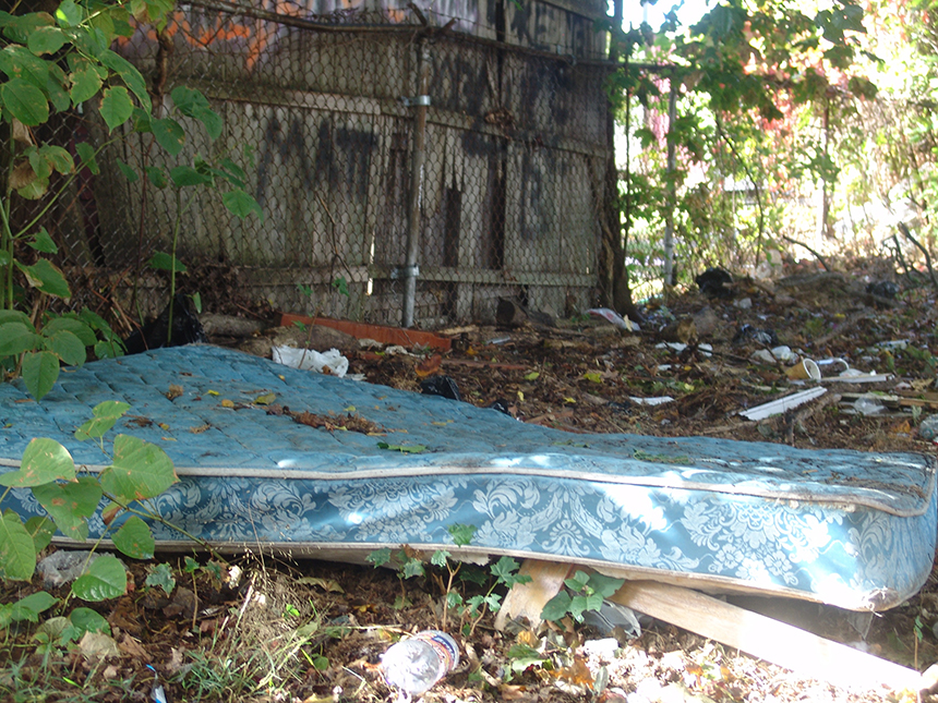 One of the wealthiest nations in the world should be outraged that millions of its citizens at any one time are homeless and have to sleep in some unappealing places, such as on this mattress in a Providence cemetery. (Frank Carini/ecoRI News photos)