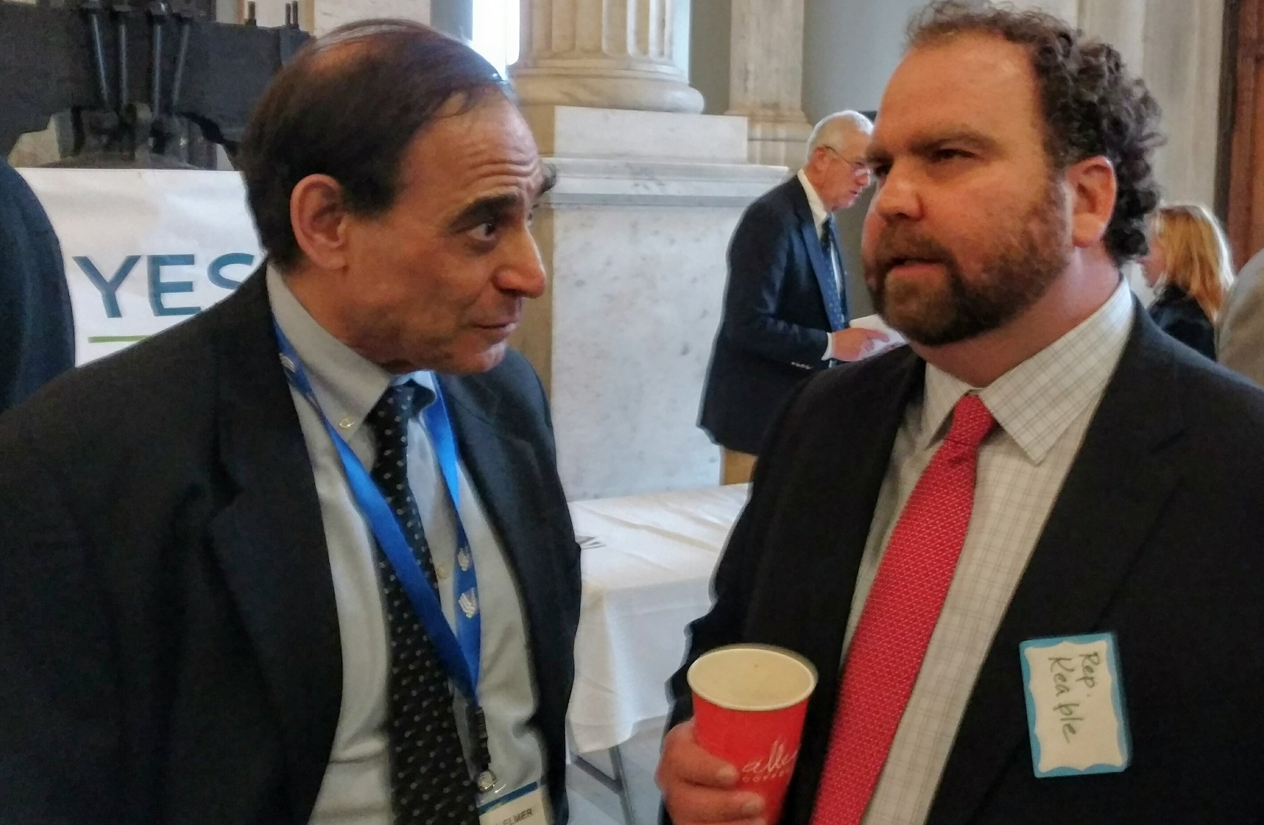 Jerry Elmer of the Conservation Law Foundation, left, speaks with Rep. Cale Keable during the annual ECRI Legislative Coffee Hour (Tim Faulkner/ecoRI News)