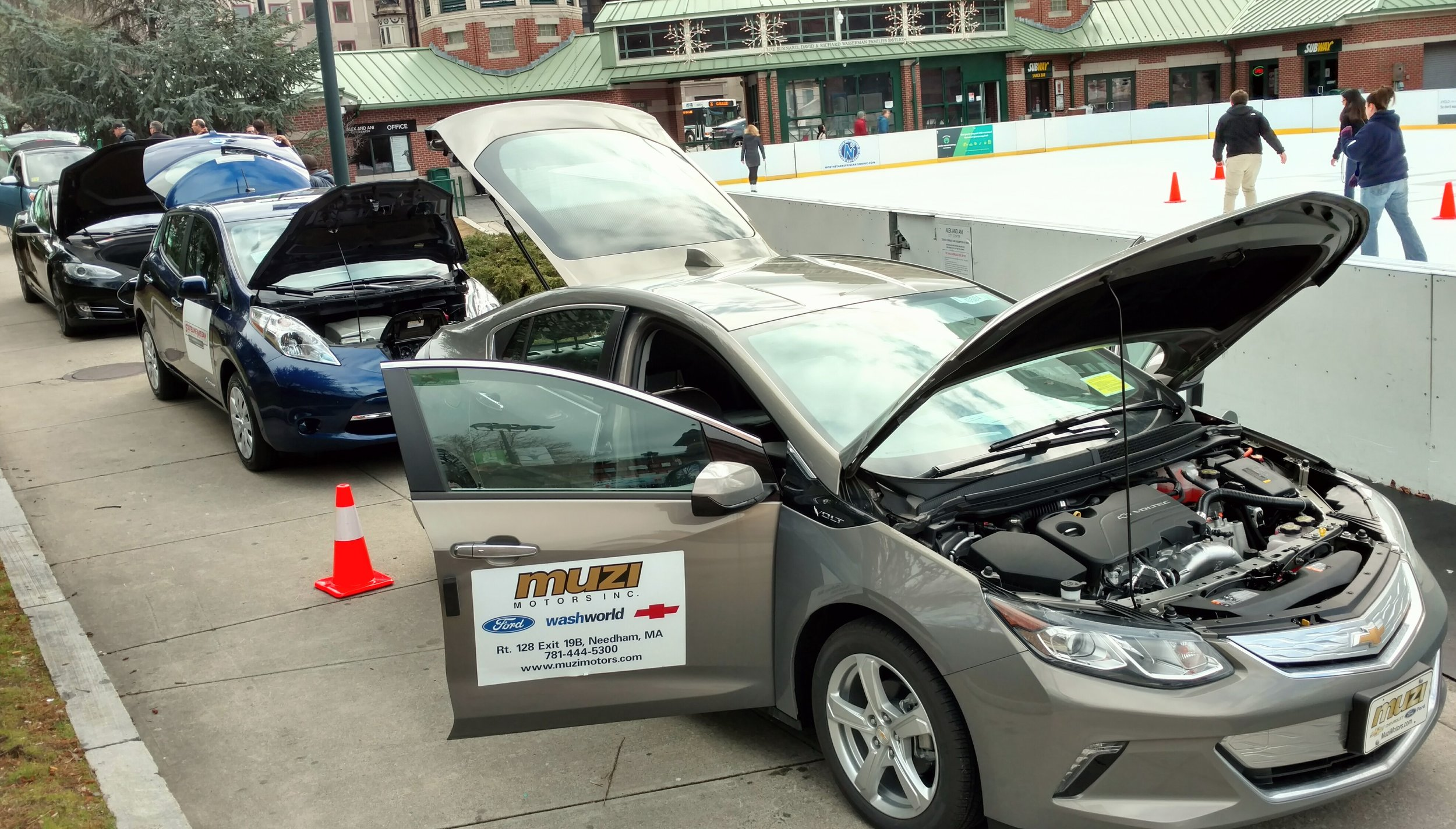 The deals are getting better for electric vehicles, such as these featured during a Jan.19 promotion at the downtown Providence outdoor ice rink. (Tim Faulkner/ecoRI News)