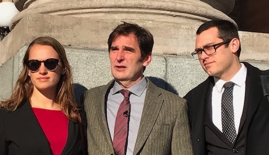 Ken Ward, middle, and his legal team after a judge declared a mistrial outside Skagit County District Court in Mt. Vernon, Wash. (Climate Disobedience Center)