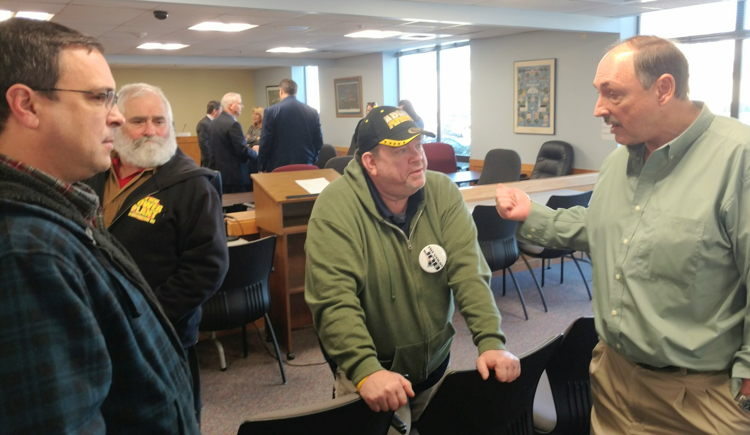 Burrillville Town Council members John Pacheco, left, Ray Trinque, middle, and town administrator Mike Wood talk after the Feb. 6 meeting.