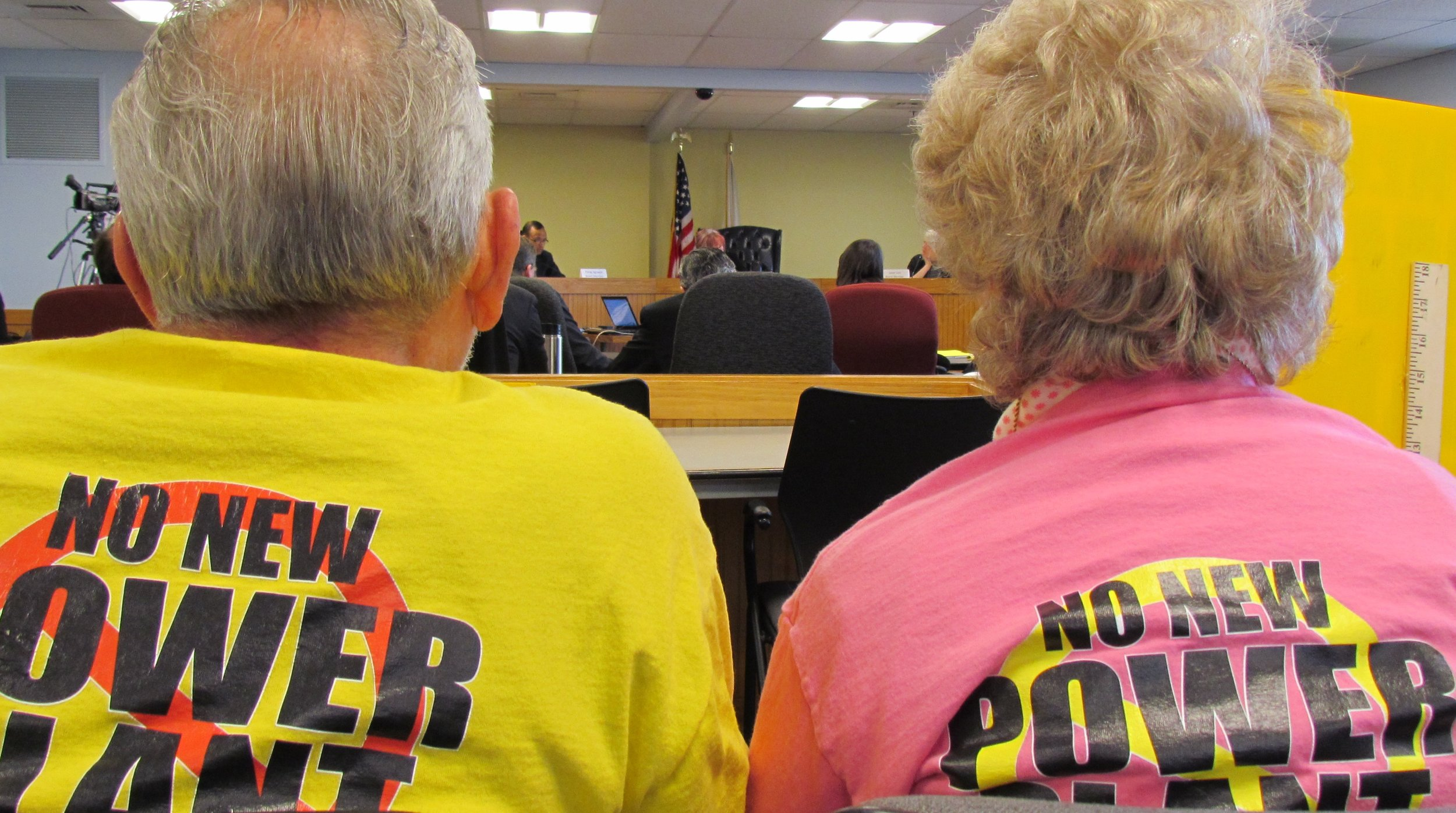 Opponents of the proposed Burrillville fossil-fuel power plant listened carefully during a recent Energy Facility Siting Board meeting. (Tim Faulkner/ecoRI News)