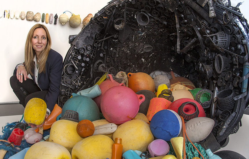 Pam Longobardi with some of the plastic she has collected from beaches around the world during the past 10 years. She makes art with some of it, to raise awareness of the world's plastic problem, archives some of it and recycles as much of it as she can. (Drifters Project)