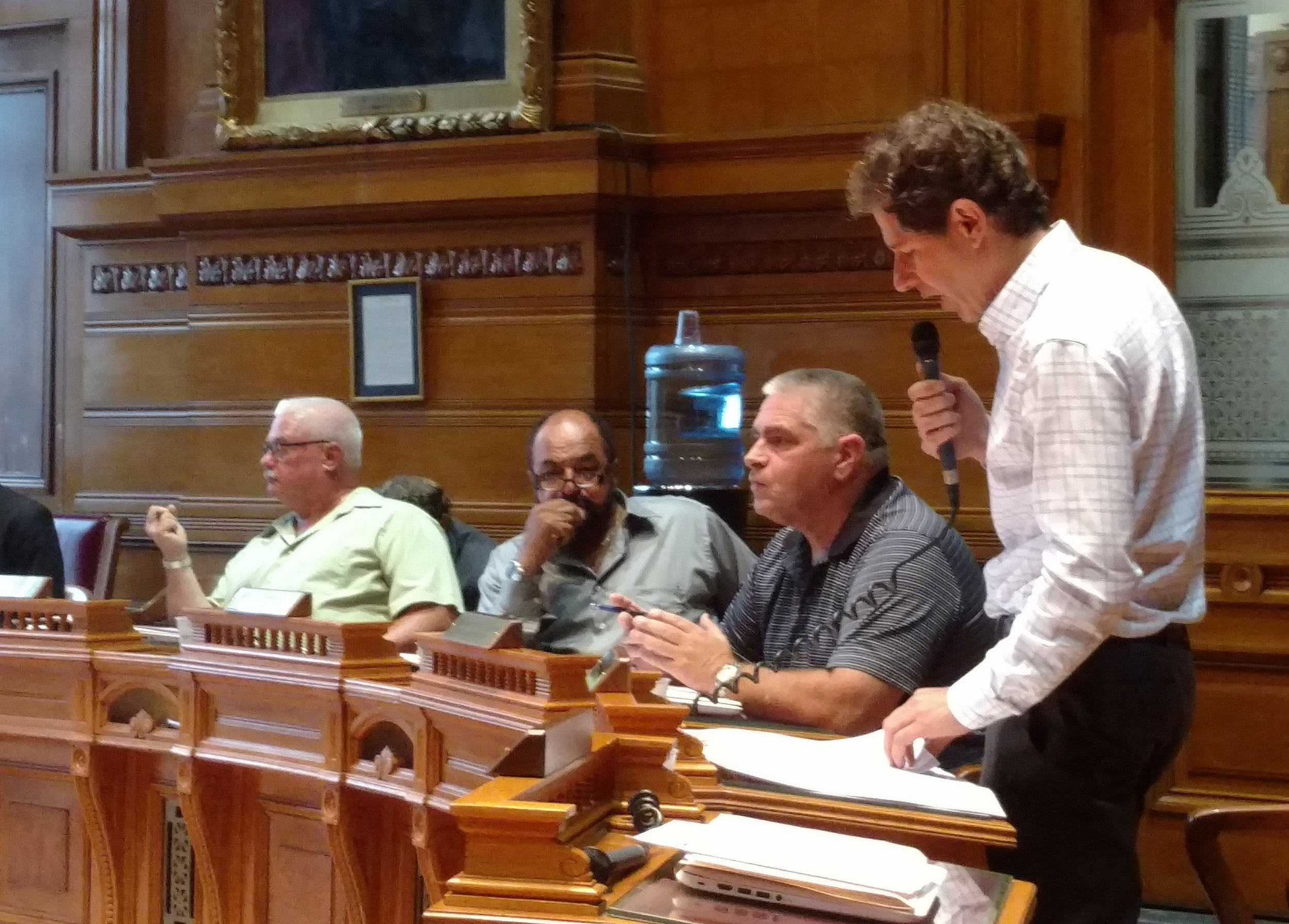 Providence City Council member Seth Yurdin reads his latest resolution to oppose the proposed Burrillville power plant during a special meeting July 24. (Tim Faulkner/ecoRI News)