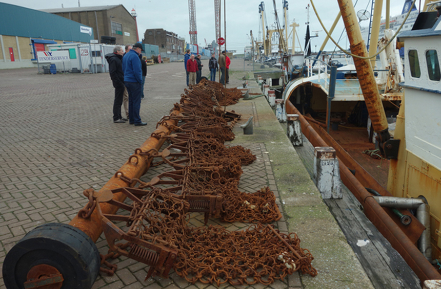 Scallop dredges attached together on a beam at a fishing dock in the Netherlands. (Jeremy Collie)