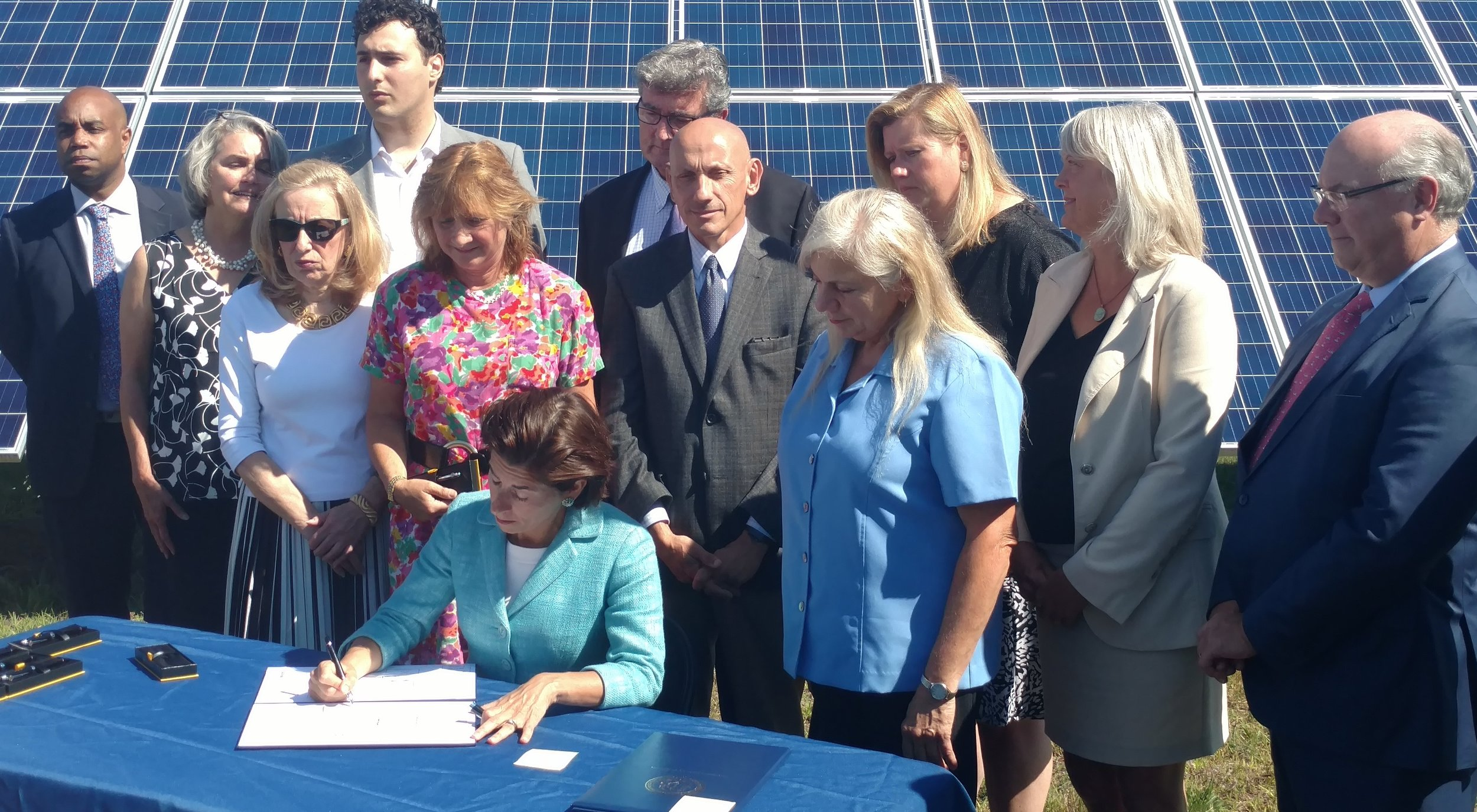 Gov. Gina Raimondo recently signed six renewable-energy bills into law. Is a carbon tax likely for next year? (Tim Faulkner/ecoRI News)