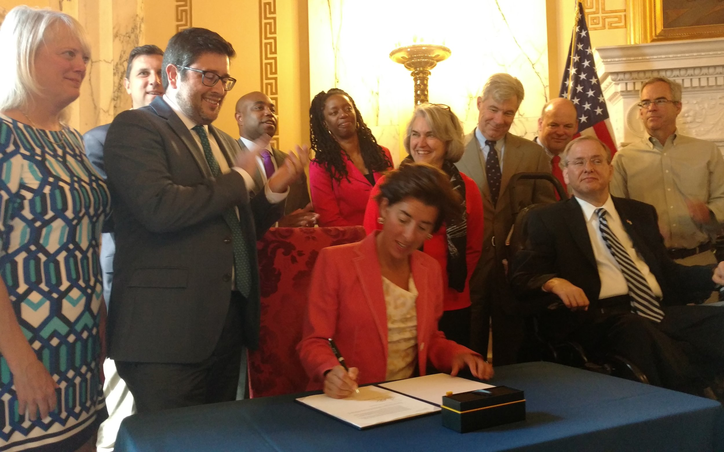 Gov. Gina Raimondo signs the Stand Up To Climate Change Executive Order.
