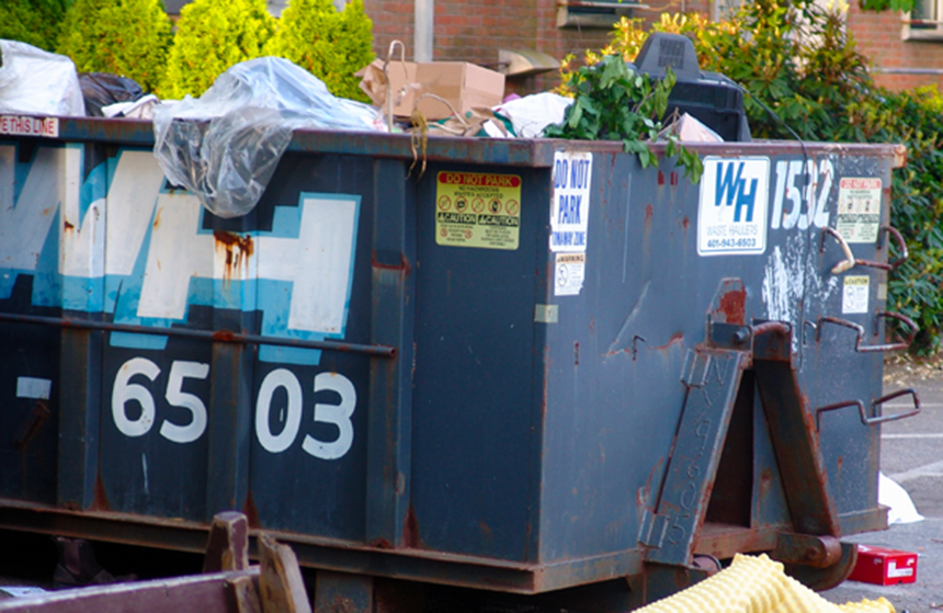 Dumpsters on the campuses of Rhode Island's colleges and universities frequently include two items, recyclables and electronics, that shouldn't be landfilled. Progress is being made, but, as this photo taken a few years ago of a Brown University Dumpster shows, there's plenty of work that still needs to be done. (ecoRI News)