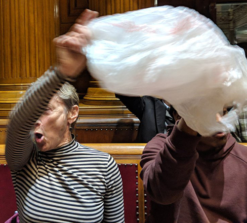 Members of Zero Waste Providence waved plastic bags as the bag-ban ordinance was introduced Feb. 15. (Tim Faulkner/ecoRI News)