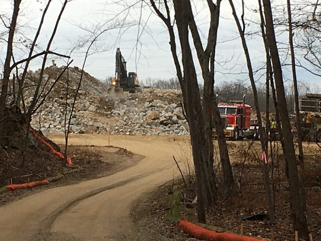 The clear-cutting of 60 acres in Cranston also included the blasting of rock and the operation of a quarry for about three months. (Douglas Doe)