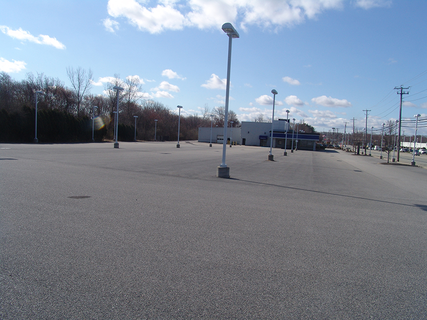 This vacant car dealership on Route 2 in Warwick has space for a solar carport, but such projects are expensive to build, and property owners have to be sold on the idea. (Frank Carini/ecoRI News)