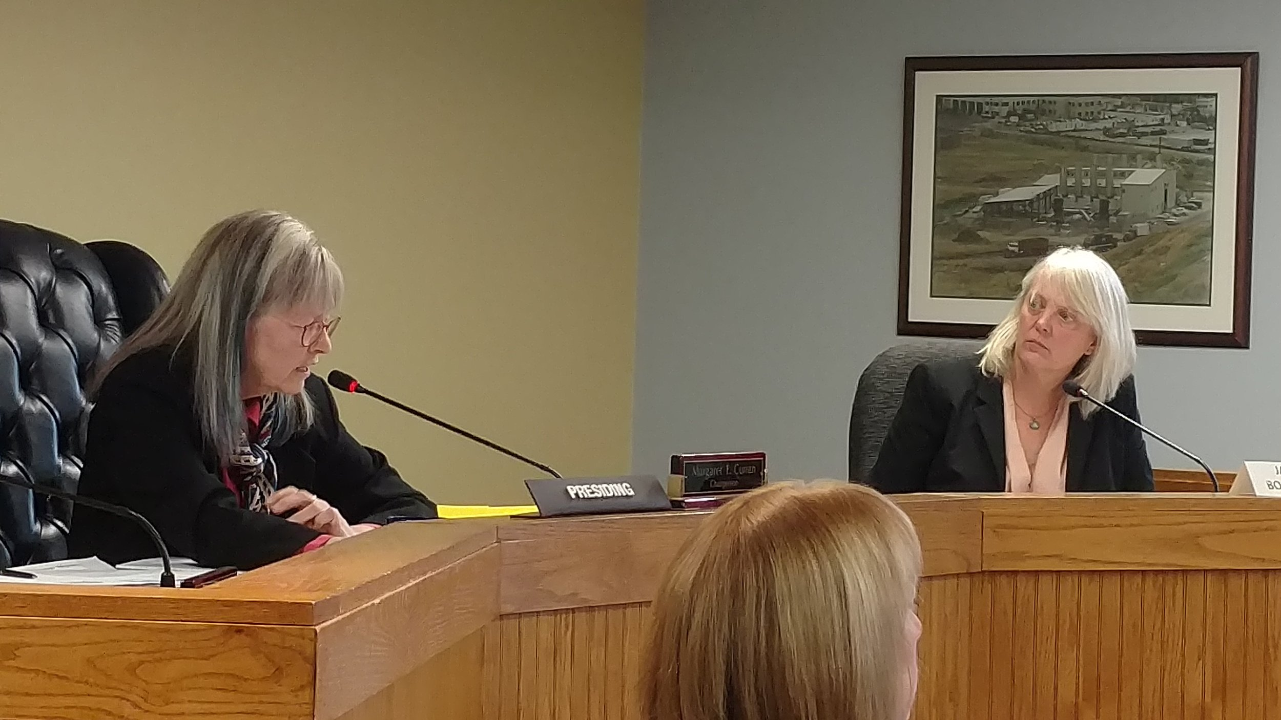 Margaret Curran, left, and Janet Coit are the remaining members of the Energy Facilities Siting Board. A bill moving through the General Assembly expands the board from three to seven members. (Tim Faulkner/ecoRI News)