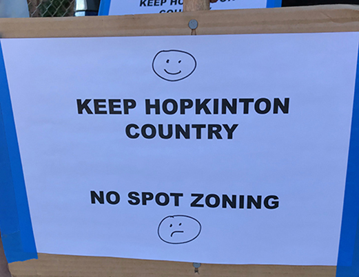 These homemade signs keep popping up in Hopkinton yards. (Frank Carini/ecoRI News)