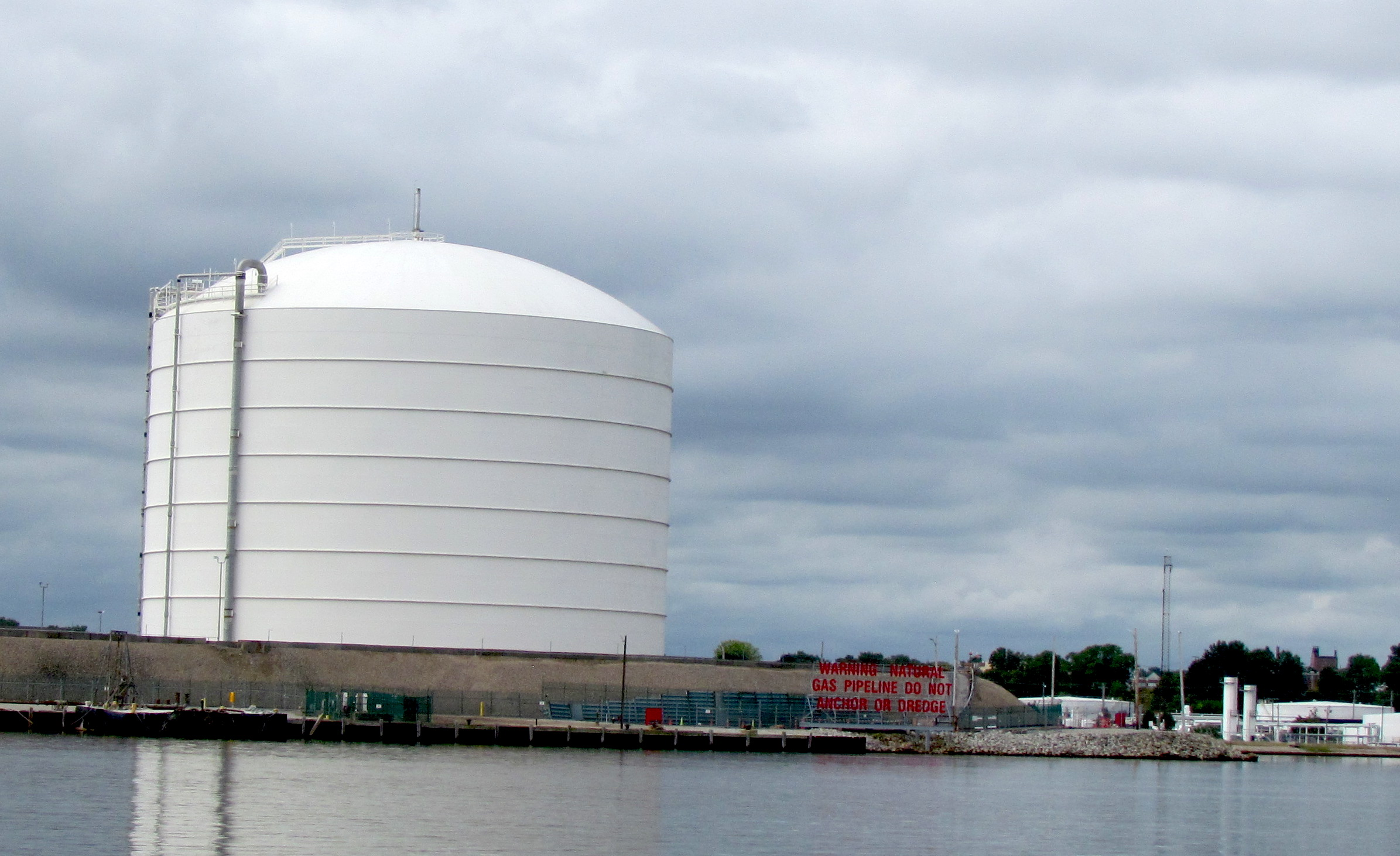 The liquefied natural gas   cooling facility will be built next to National Grid's 127-foot LNG storage tank on the Providence River. (Tim Faulkner/ecoRI News)