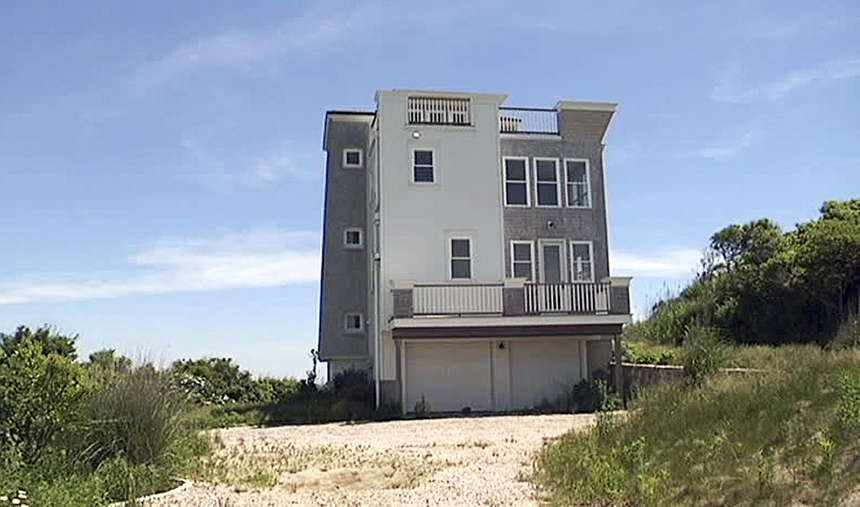 This $1.8 million waterfront house was built illegally in a public park in Narragansett. (AP)