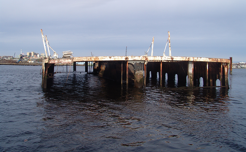 This half-sunk car ferry is just one of several junk vessels that have polluted the Providence River. The companies responsible haven't been held accountable. (Frank Carini/ecoRI News)