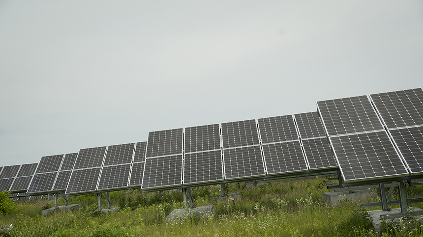 This solar panel field in West Kingston, R.I., is located on a capped waste disposal site. It was developed and is owned by Kearsarge Energy as part of the South Kingstown Solar Consortium, which includes the towns of Narragansett and South Kingstown and the University of Rhode Island. (Nora Lewis/URI)