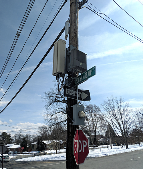 Wireless equipment like this found on a utility pole at the corner of Rochambeau Avenue and Blackstone Boulevard in Providence will likely be installed across the city under plans for a new 5G network. City officials, RIDOT, and National Grid, which owns the pole, have been slow to answer questions about the equipment. (Tim Faulkner/ecoRI News)