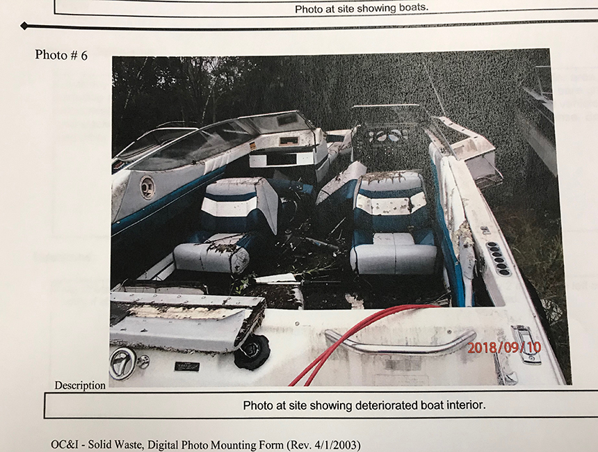 Wright's Auto Parts was cited late last year for having nearly 170 cubic yards of solid waste on the property, including 10 boats and more than 480 used tires. (Frank Carini/ecoRI News)