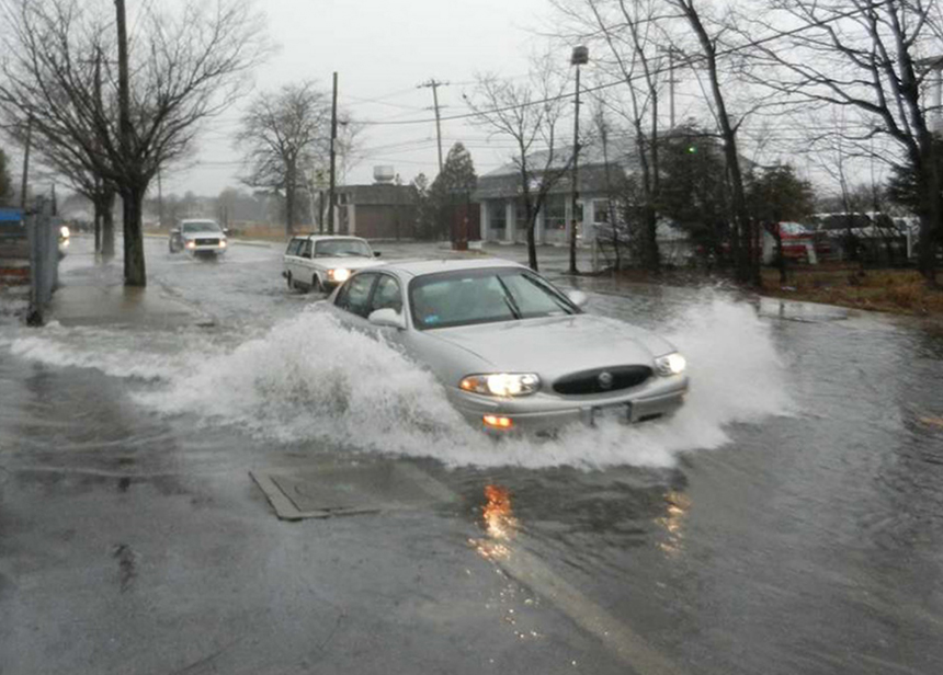 Coastal flooding, as seen here in March 2014 on Main Street in Warren, R.I., is being caused by more frequent and intense rains and storms. (ecoRI News)