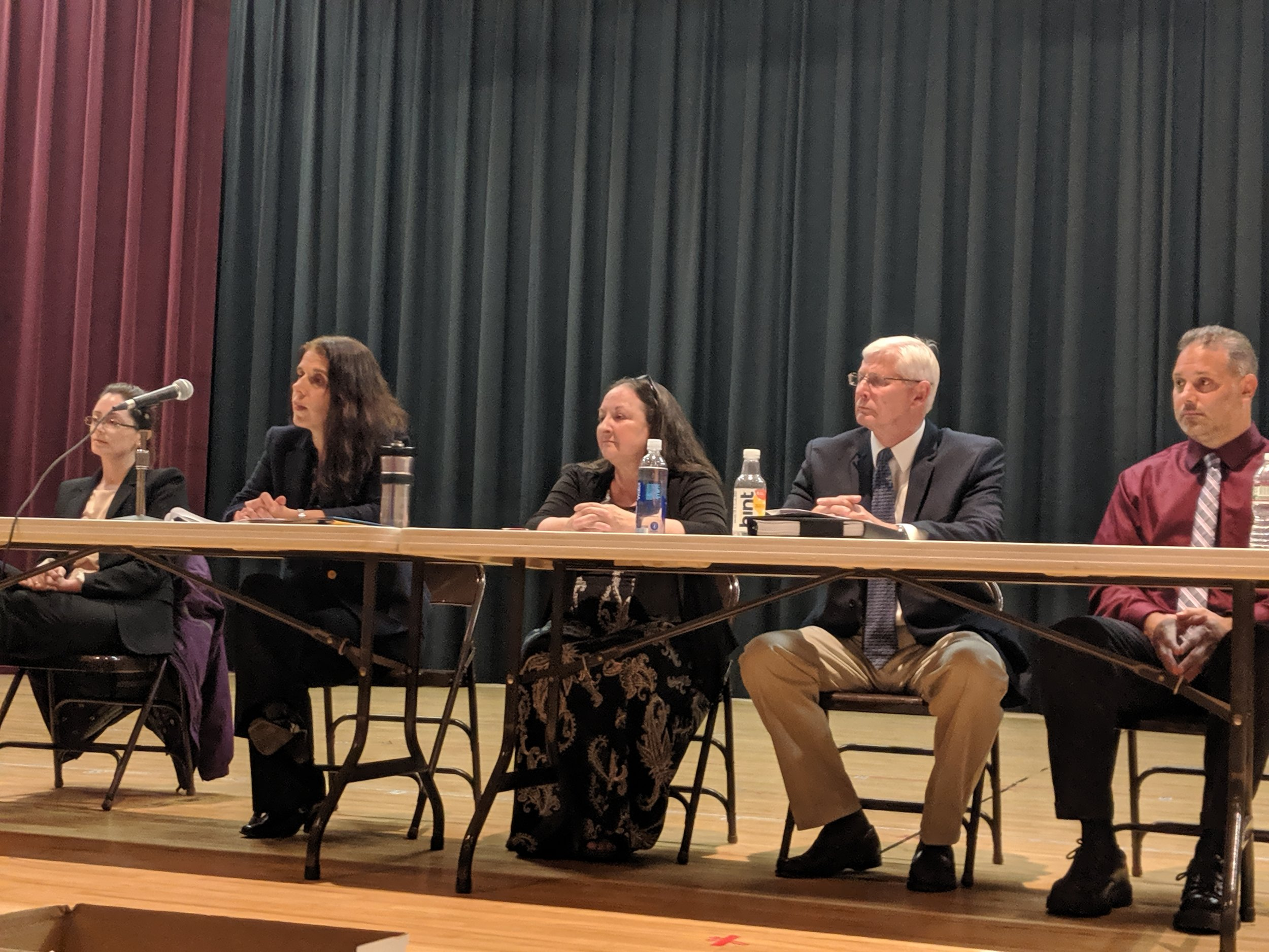 A panel from the Rhode Island Office of Air Resources heard comments from opponents of the proposed Clear River Energy Center. (Tim Faulkner/ecoRI News)