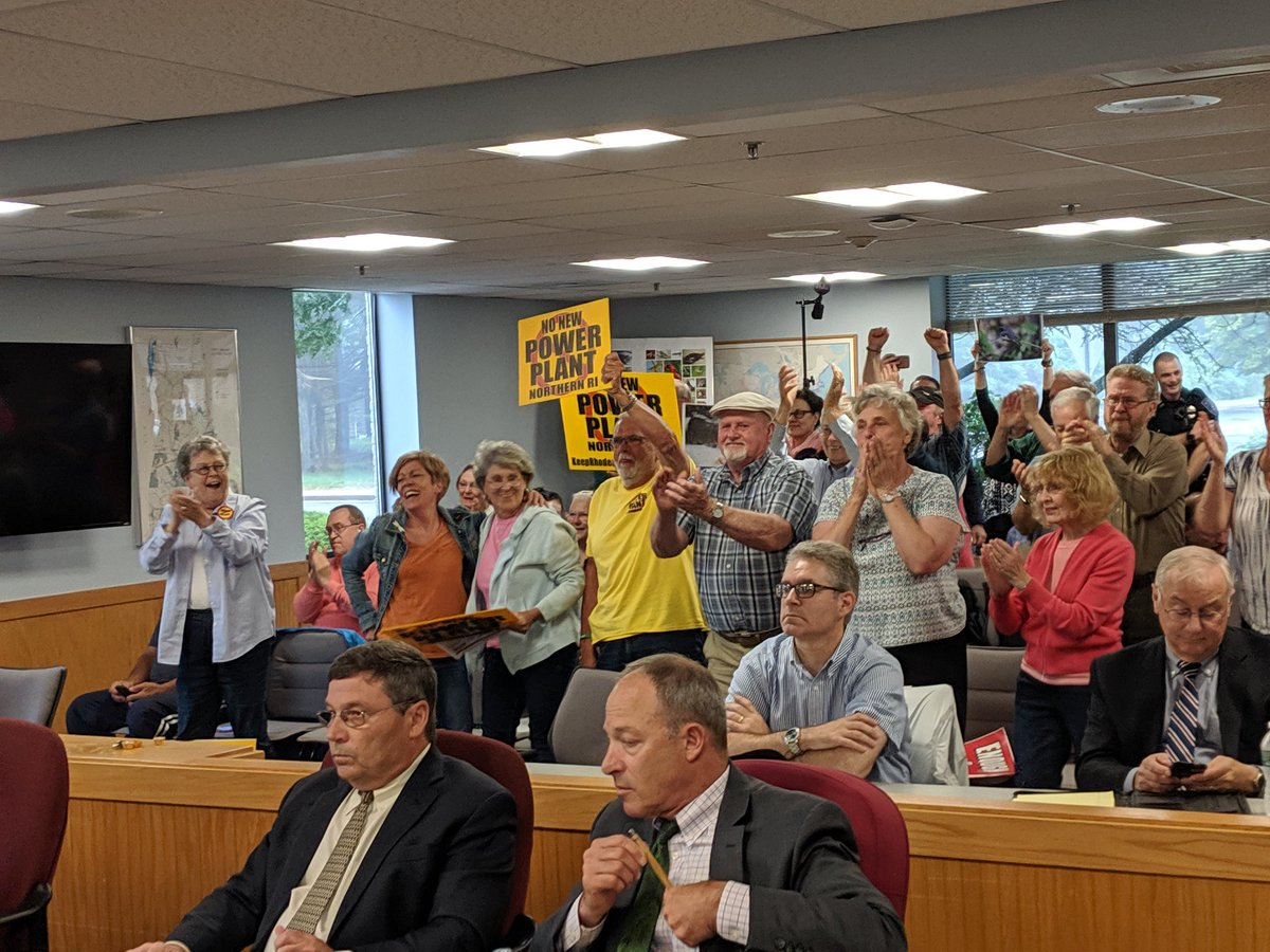 Opponents of the proposed Clear River Energy Center celebrate the vote by the Energy Facility Siting Board. (Tim Faulkner/ecoRI News)