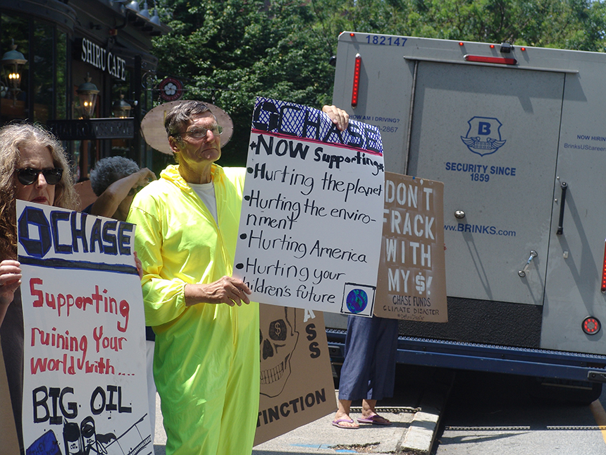 Local climate activists are tired of Chase Bank backing up the Brink's truck for fossil-fuel projects. (Frank Carini/ecoRI News photos)