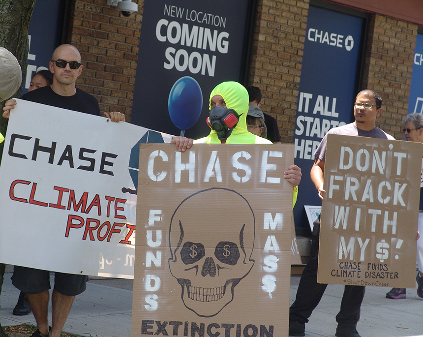 The protest was held at the location where Chase Bank is set to open its first Rhode Island branch, 234 Thayer St. in Providence. The activists want Rhode Islanders to reject the New York City bank until it changes its practices.