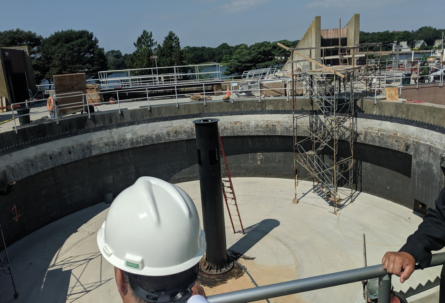 A solid-waste separation tank at the sewage treatment plant in Warren, R.I., was raised to 16 feet to withstand a 100-year storm and sea-level rise. (Tim Faulkner/ecoRI News)